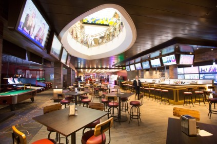 Royal Caribbean International's Independence of the Seas in Southampton, UK, after her multi-million pound makeover. She will homeport in Southampton for the summer season. Playmakers Sports Bar and Arcade